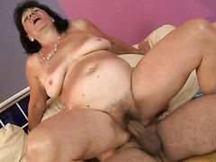 Brunette Helena May with massive breasts has
