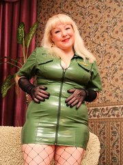 Blonde mature Cynthia with huge tits and in net stockings riding a huge cock on the floor