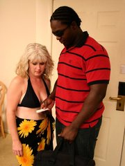 Blonde MILF gets a black stud stuffing her with dick