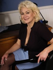 Blonde granny masturbating in the office