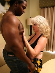 Mature housewife Stacey gets dirty with her black hottie and takes in his big cock in her mouth and