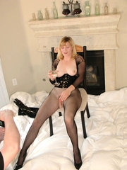 Experienced blonde hammering her soaked twat with a black dildo.