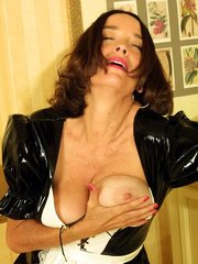 Maid-Looking Mature in Stockings Spreading and Licking Her Tits