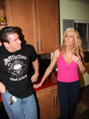 A buxom blonde couger getting a hot meat injection at home