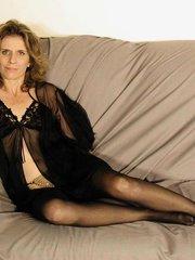Matured brunette in her black nighties masturbating lustfully on the sofa