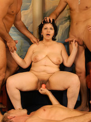 Horny granny Beth Morgan and her friends go for simultaneous fucking and play with toys in this orgy