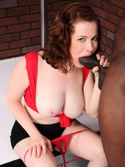 Redheaded couger starring in sexy interracial hardcore