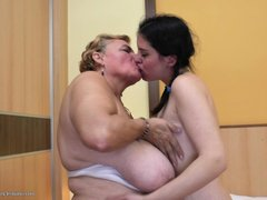 Watch this beautiful young lady making lesbian love with that old woman. It all started with kisses